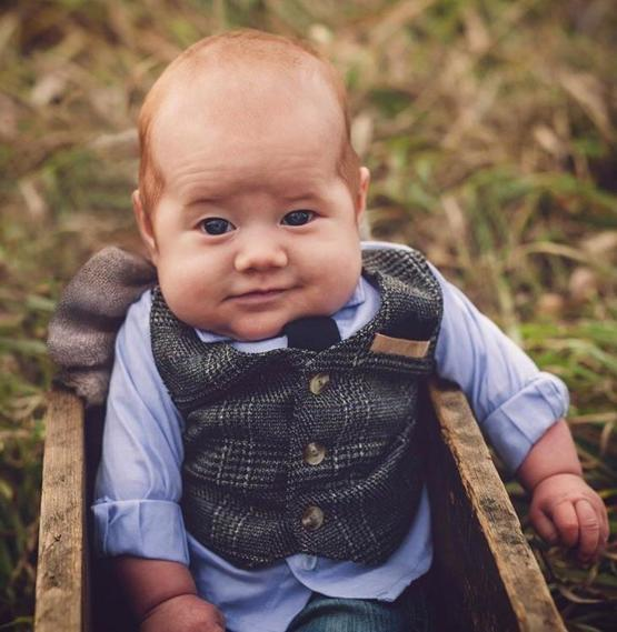 This baby looks like he's ready to pour you a pint at his pub.....
