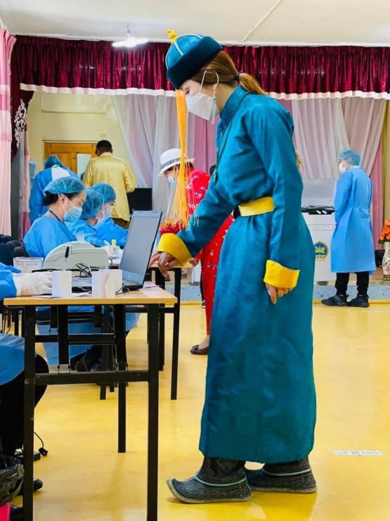 A girl in national dress is voting in the election. Mongolia