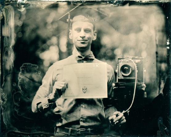 I just graduated university and in lieu of the usual school photo, I made a tintype self portrait.