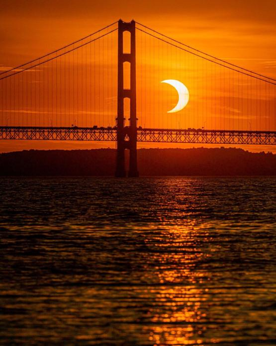 I lined up this morning's solar eclipse behind the Mackinac Bridge in northern Michigan.