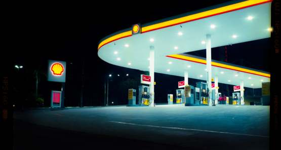 A picture I took with my film camera of this interestingly shaped gas station.