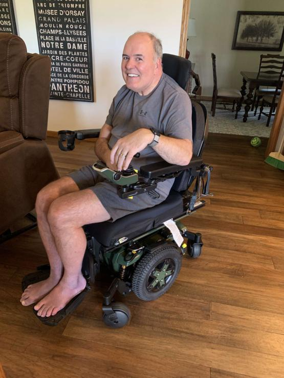 My dad in his new motorized wheelchair. The absolute cutest