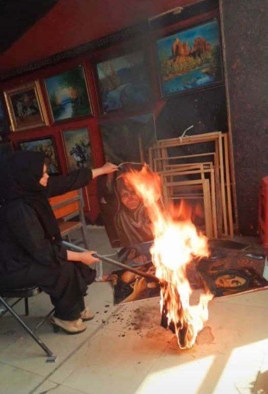 an afghan woman destroys her paintings to avoid persecution by the taliban