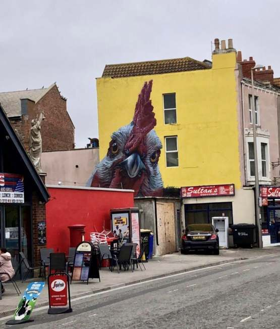 This realistic chicken art in my home town