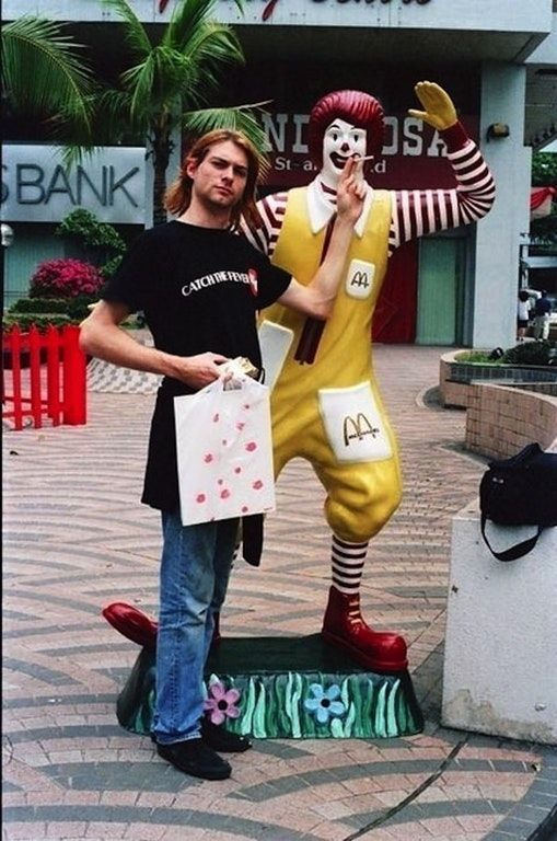 Kurt Cobain having a smoke with Ronald McDonald in Singapore, (1992).
