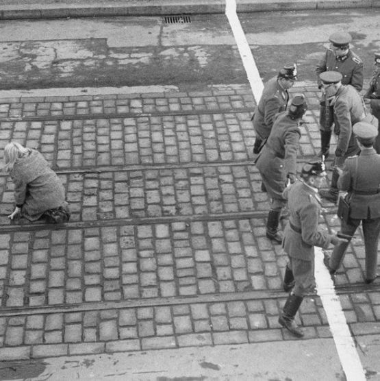 Young girl barely makes it across the border between East and West Berlin, 1955.