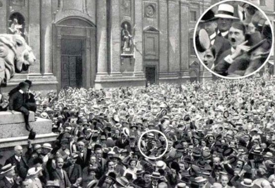 1914 - Young Adolf Hitler celebrating the announcement of World War One.