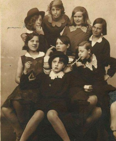 Teens pose as delinquents in this photo. 1930