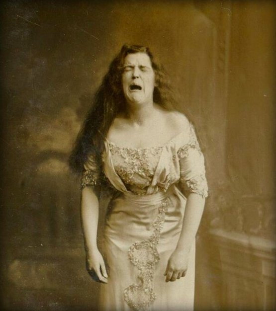 One of the oldest photos of a sneezing woman, c. 1900