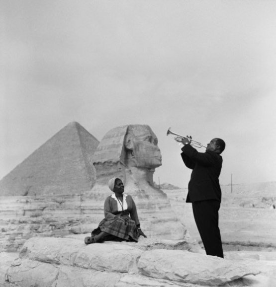 Louis Armstrong plays for his wife in front of the Sphinx by the pyramids in Giza, 1961.