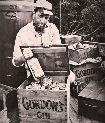 Humphrey Bogart with a few cases of Gordon's gin