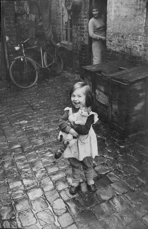 Happy French girl and her cat, Roubaix, 1958. Photograph by Jean-Philippe Charbonnier.