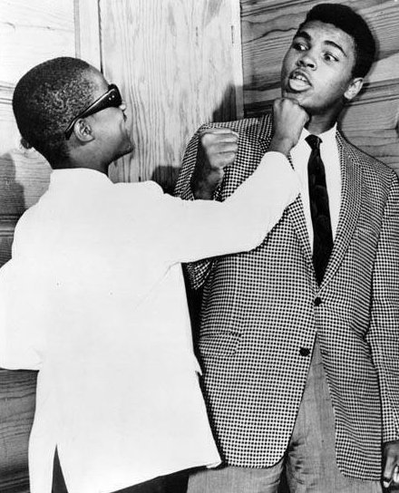 13 year old Stevie Wonder goofing around with Muhammad Ali at The Apollo, Harlem, 1963