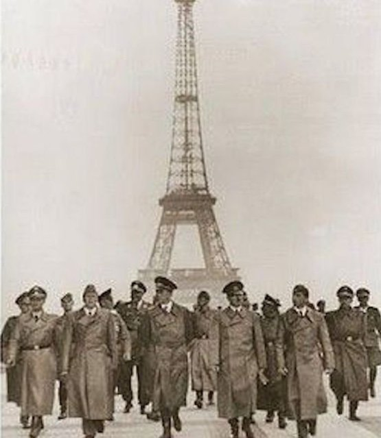Hitler and his entourage walking in front of the Eiffel Tower,1940 -