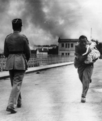 A journalist dashes across a bridge between to rescue a baby during Civil War. 1936.