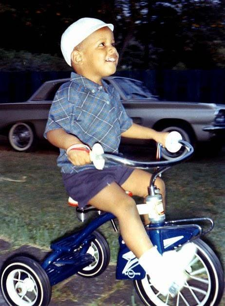 A young Barack Obama riding a tricycle, 1965