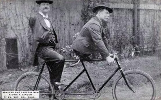 Charles B. Tripp, the armless man and Eli Bowen, the legless man, riding a tandem. 1890s
