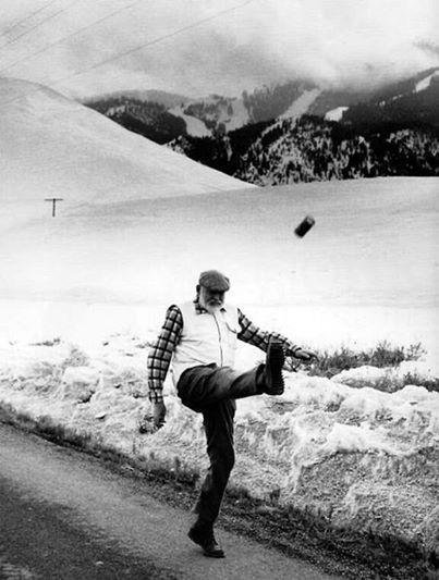 Ernest Hemingway kicking a beer can, 1959. Photograph by John Bryson.