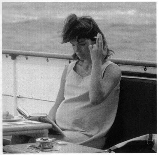 Former First Lady Jackie Kennedy smoking a cigarette while pregnant in 1963.