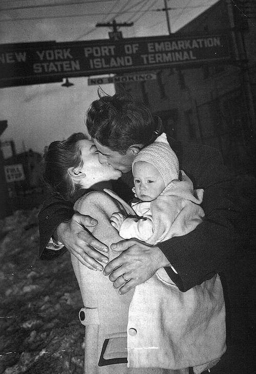 A US soldier is welcomed home by his wife and baby, 1940s