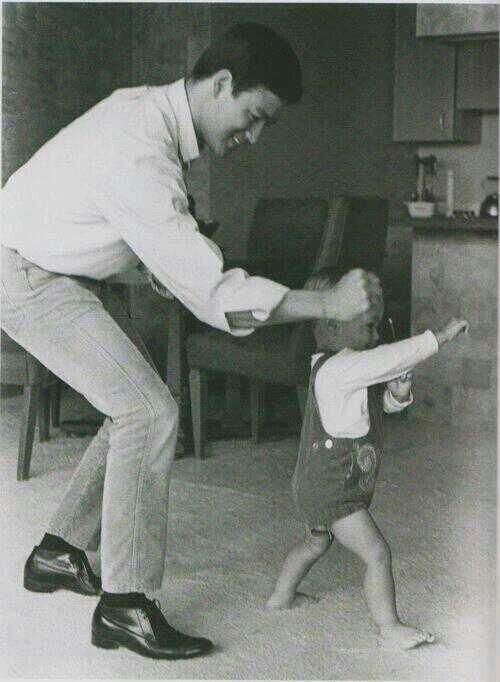 Bruce Lee playing with his son Brandon, 1966