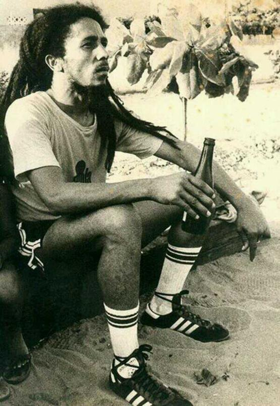 Bob Marley enjoys a beer after a football match