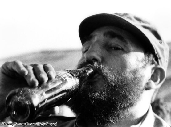 Fidel Castro enjoys a bottle of Coca-Cola, circa 1972.