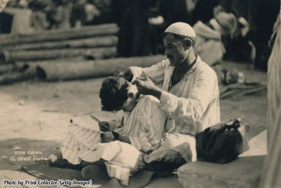 A street barber in Cairo, Egypt, 1936.