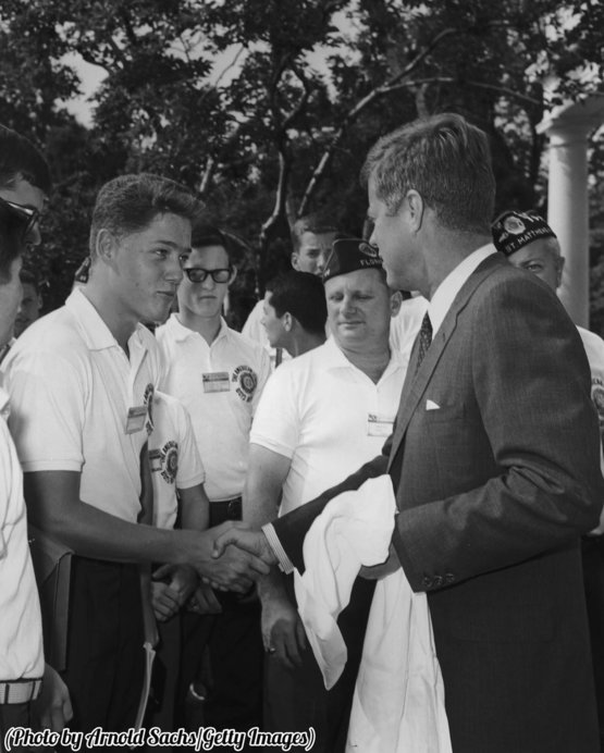 A teenage Bill Clinton shakes President John F. Kennedy's hand, Washington DC, 1963.