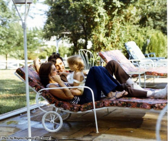 Elvis, Priscilla, and Lisa Marie Presley relaxing at home, 1968.