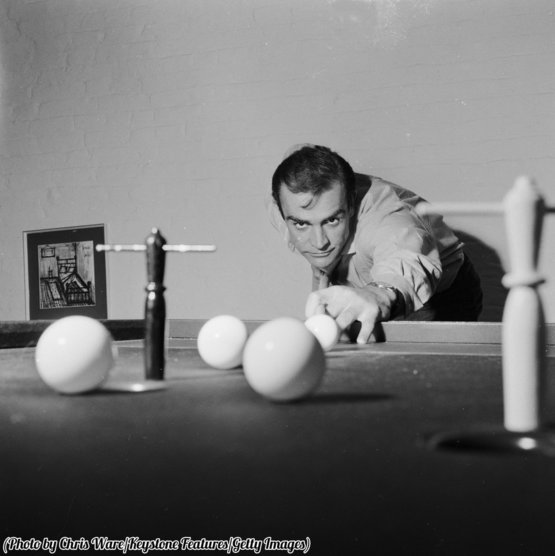 Sean Connery plays billiards at his home in London, 1962.