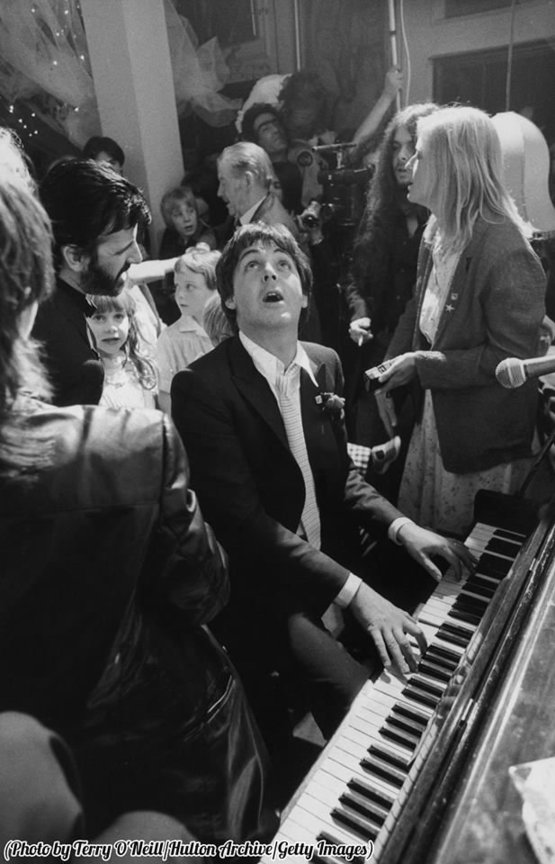 Paul McCartney playing piano at the wedding reception of Ringo Starr and Barbara Bach, 1981.