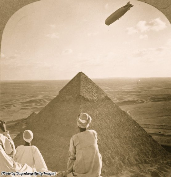 A Zeppelin flying above the more than 4,000 year old pyramids of Giza in Egypt, 1931.