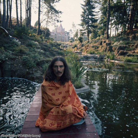 George Harrison posing in peaceful surroundings at Friar Park, Henley, 1975.