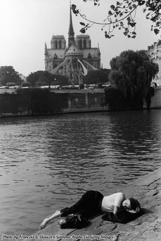 Relaxing by the Seine with a view of Notre-Dame de Paris, 1980.