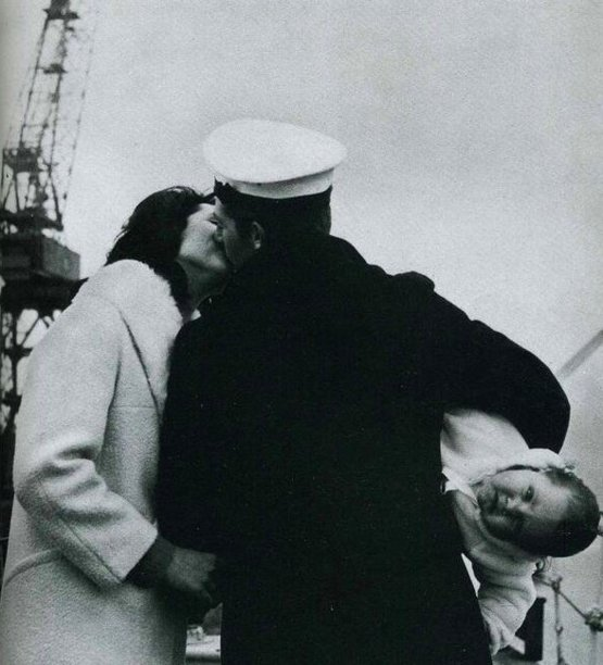 A seaman meets his baby for the first time after fourteen months at sea, 1940s.