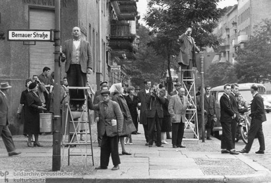 Stunned West Berliners watch the Berlin Wall being built, August 13, 1961