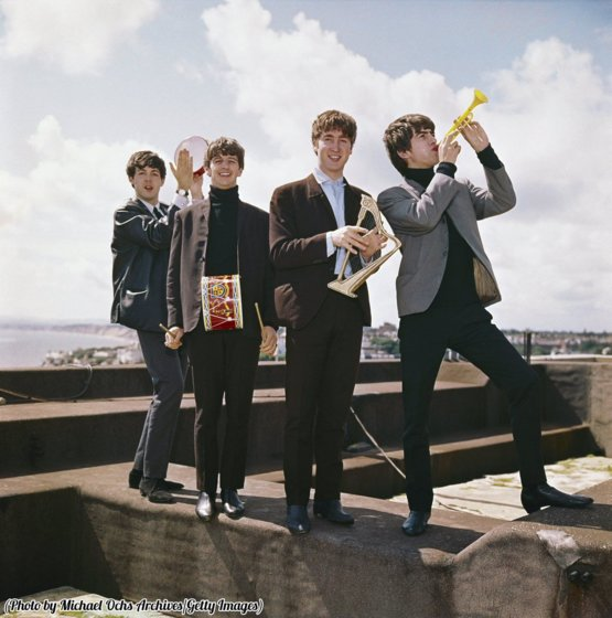 The Beatles pose for a portrait with miniature toy instruments, circa 1964.