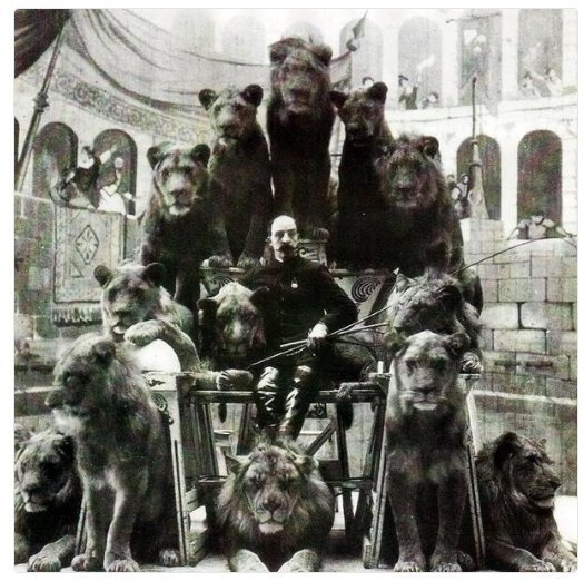 Animal Tamer Captain Jack Bonavita sitting down with some of his cats, ca. 1903.