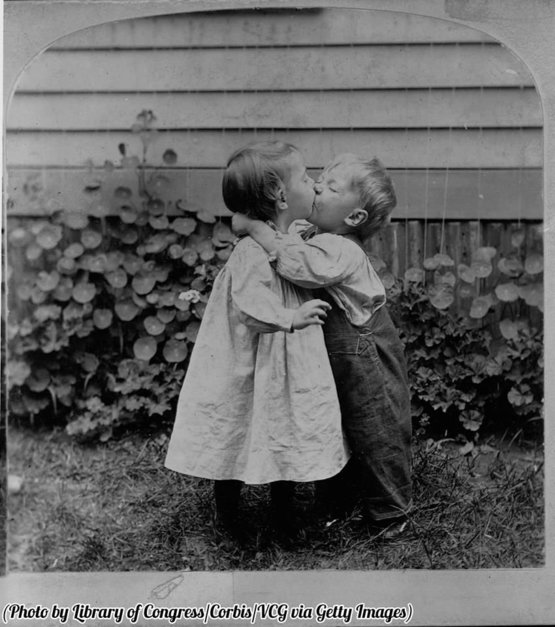 Two kids kissing, circa 1890.
