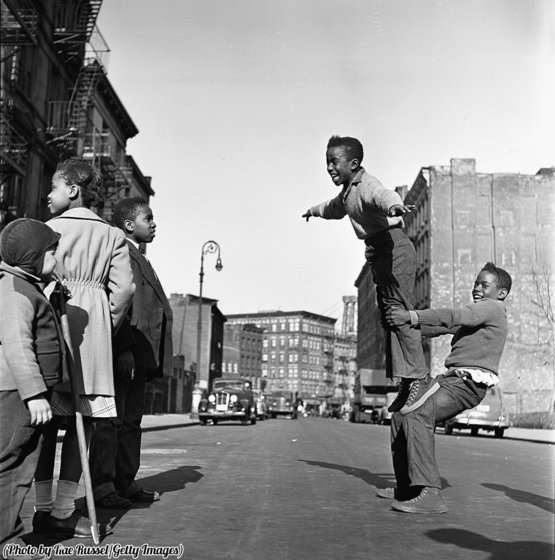 A group of young kids as play on the street, Brooklyn, New York, New York, 1948.