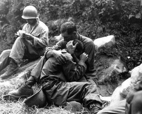 Soldiers comfort each other during the Korean war in the early 1950's.