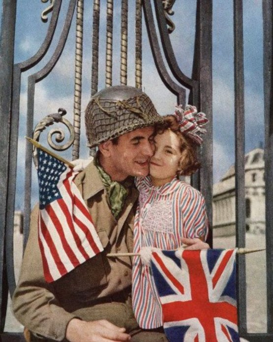 A French girl welcomes her country's liberators outside the Palace of Versailles, 1945.