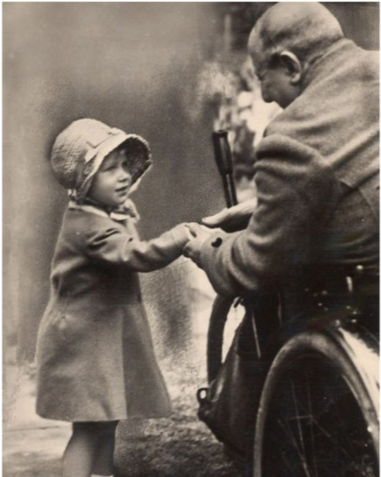 Queen (then Princess) Elizabeth II shakes hands with an old soldier in London, circa 1929.