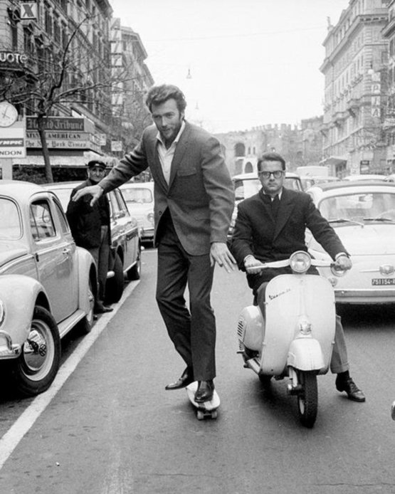 A young Clint Eastwood skateboards through the streets of Rome in 1964.
