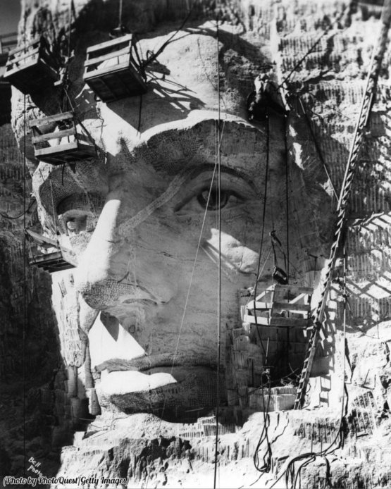 Close-up of Lincoln Head at Mount Rushmore under construction, South Dakota, 1937.