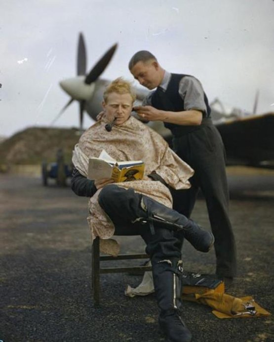 Royal Air Force pilot getting a haircut during a break between missions, Britain, 1942