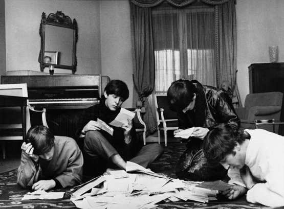 The Beatles reading fan mail, 1964 (By Harry Benson)