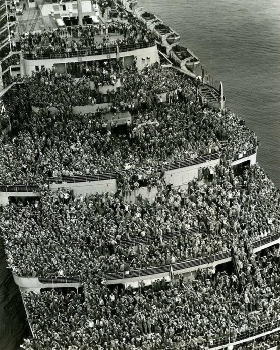 "The liner ""Queen Elizabeth"" bringing American troops into NY Harbor at the end of WW II, 1945."