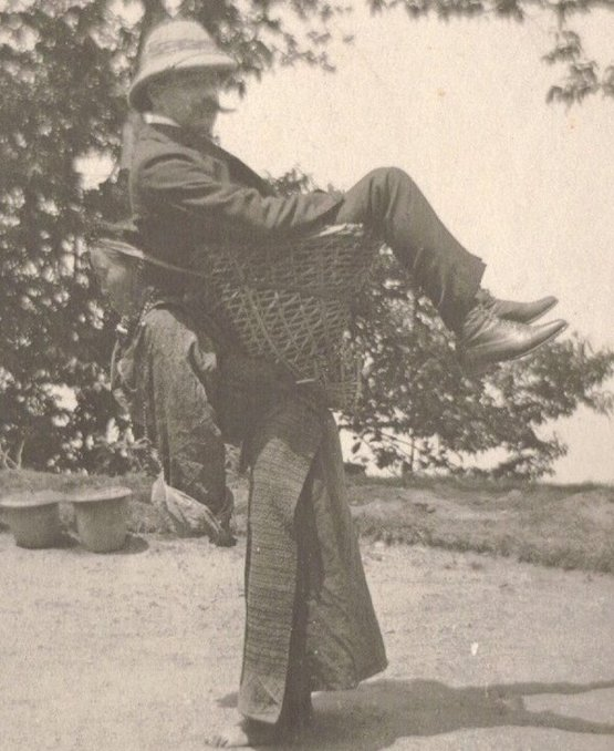 A Sikkimese woman carrying a British man on her back, West Bengal, India, circa 1900